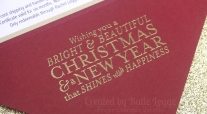 Stampin Up Christmas Gift Certificate - Closeup of gold embossing greeting - Katie and Rachel Legge